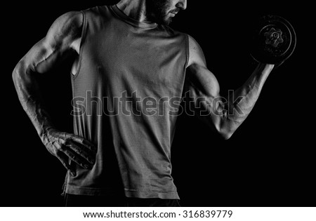 Fitness muscular body on dark background. - stock photo