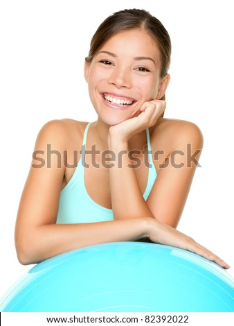 Fitness pilates woman smiling happy portrait isolated on white background. Healthy lifestyle image of beautiful young mixed race Asian / Caucasian female fitness model isolated on white background.