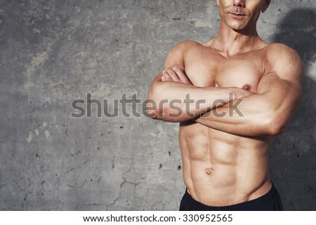 Fitness portrait half body six pack no shirt, fitness concept, room for copyspace, fit and healthy male body with abdominal muscles