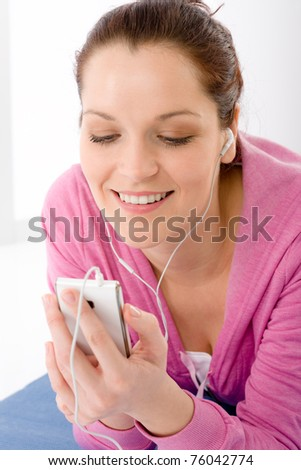 Fitness portrait of woman listen music mp3 relax in gym - stock photo