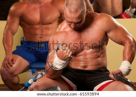 Fitness - powerful muscular man doing weightlifting in gym - stock photo