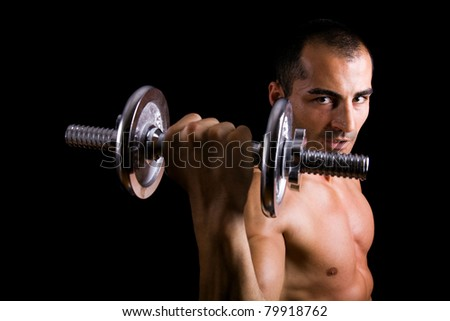 Fitness - powerful muscular man lifting weights