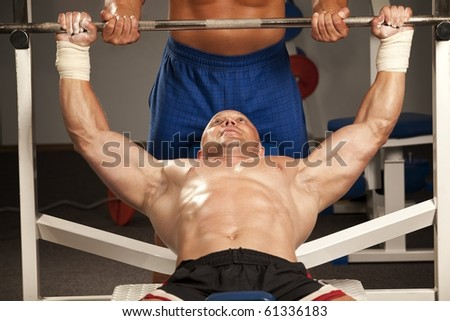 Fitness - powerful muscular man with a bar weights in hands training - stock photo