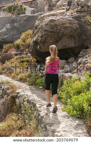 Fitness. Runner woman running on mountain road in beautiful nature. Caucasian female sport fitness model jogging training. - stock photo