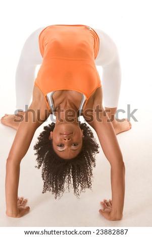 Fitness series - Dark skinned fit woman holding bridge stretching pose - stock photo