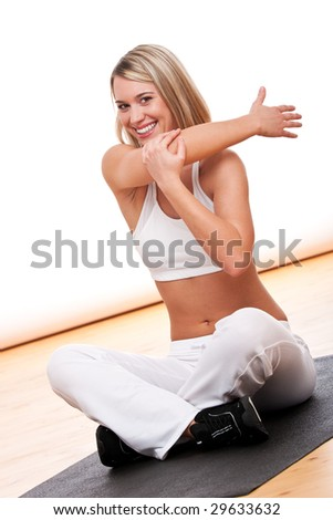 Fitness series - Smiling woman stretching on mat - stock photo
