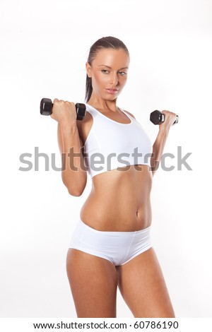 Fitness sexy woman working out with free weights isolated on white - stock photo