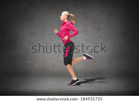 fitness, sport and dieting concept - beautiful sporty woman running - stock photo