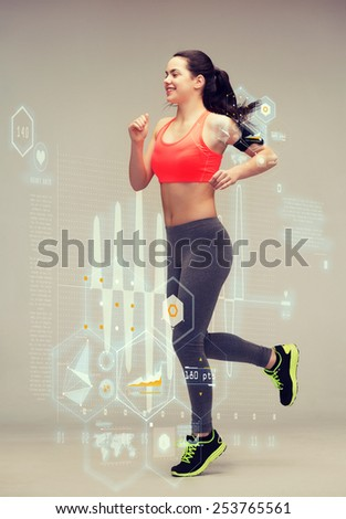 fitness, sport and dieting concept - beautiful sporty woman running or jumping - stock photo