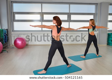 Fitness, sport, exercising lifestyle - Happy women wear in bodysuits doing exercises at gym