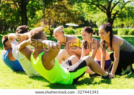 four people relaxing after workout park stock photo 519789298 shutterstock. Black Bedroom Furniture Sets. Home Design Ideas
