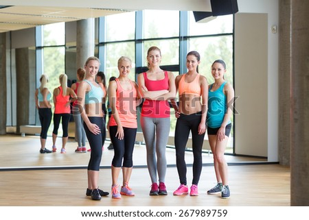 fitness, sport, friendship and lifestyle concept - group of women in gym - stock photo