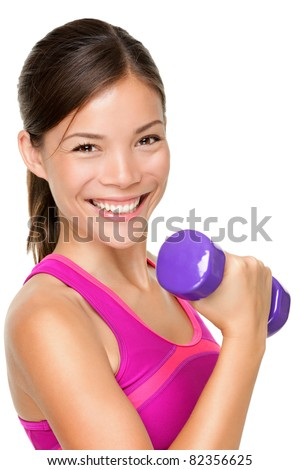 Fitness sport girl smiling happy. Fitness woman lifting dumbbells strength training biceps doing curls. Mixed Caucasian and Asian fitness model portrait isolated on white background. - stock photo