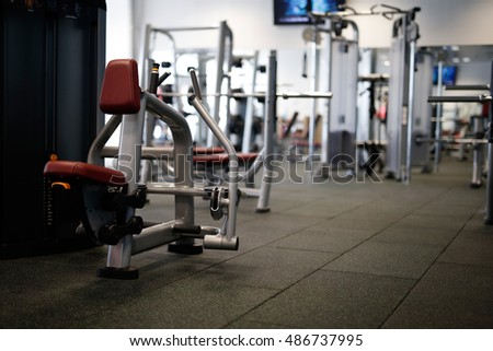 Fitness sport gym without people. Modern gym interior with equipment .