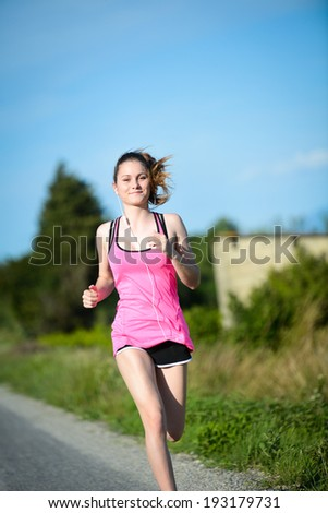 fitness sport healthy cheerful young woman running outdoor in the countryside - stock photo