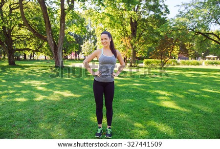 fitness, sport, people and healthy lifestyle concept - happy young woman exercising outdoors - stock photo