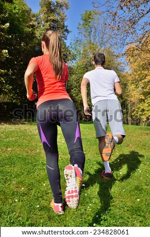 fitness, sport, training and lifestyle concept - smiling couple stretching outdoors - stock photo