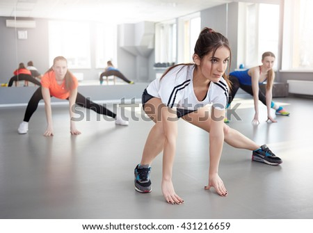 fitness, sport, training and lifestyle concept. Sporty young women exercising at fitness studio. pilates - stock photo