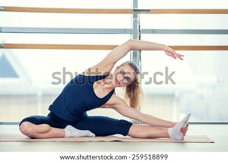 fitness, sport, training and lifestyle concept - woman doing exercises on mat in gym - stock photo