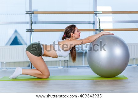 fitness, sport, training and people concept - woman with fitness ball - stock photo