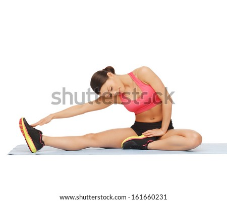 fitness, sport, training, gym and lifestyle concept - beautiful sporty woman doing exercise on the floor - stock photo