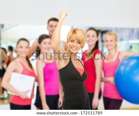 fitness, sport, training, gym and lifestyle concept - lovely fit woman with expression of triumph over white - stock photo
