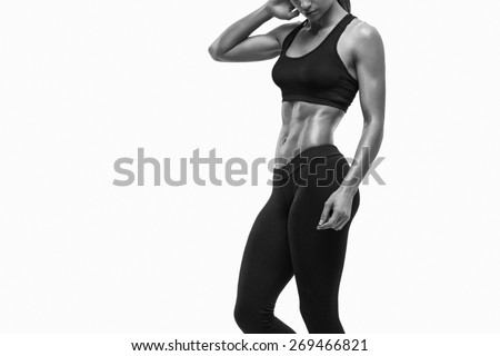 Fitness sporty woman showing her well trained body. Strong abs showing. - stock photo