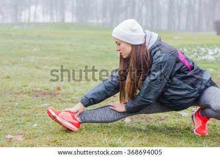 Fitness Sporty Young Woman, outdoor exercising activity , winter season.