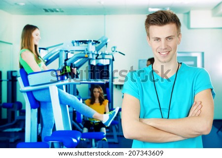 Fitness trainer at gym - stock photo