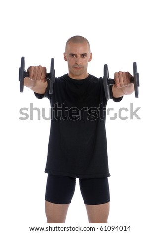 Fitness trainer exercising in gym - stock photo