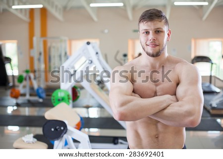 fitness trainer in gym on background - stock photo