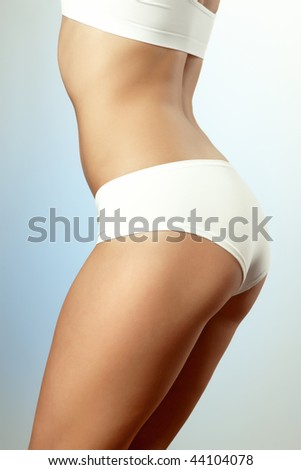 fitness trainer's body - stock photo