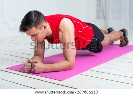 fitness training athletic sporty man doing plank exercise in gym or home concept exercising workout aerobic. - stock photo