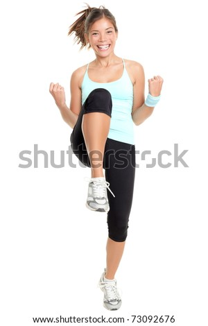 Fitness woman aerobics. Fresh energetic female fitness instructor doing aerobics. Full body image of beautiful multiracial Chinese Asian / Caucasian female model isolated on white background. - stock photo