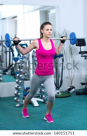 Fitness Woman. Attractive young woman is engaged in fitness sport club - stock photo