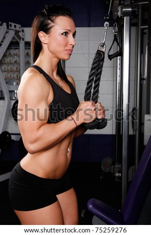Fitness woman demonstrates proper technique - stock photo