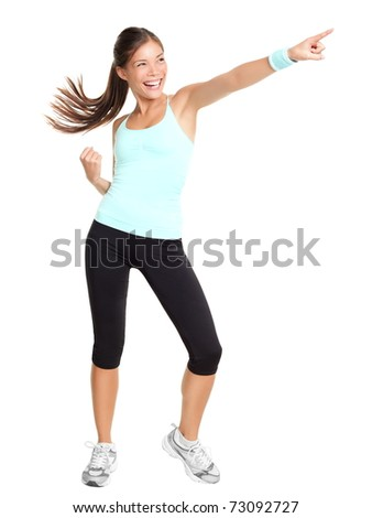 Fitness woman doing aerobic pointing. Sporty energetic beautiful model isolated in full length on white background. - stock photo