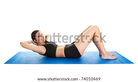 Fitness woman doing crunches on gym mat - stock photo