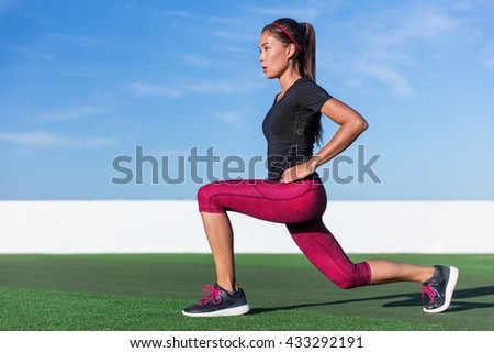 Fitness woman doing lunges exercises for glute and leg muscle workout training core muscles, balance, cardio and stability. Active girl doing front forward one leg step lunge exercise. - stock photo