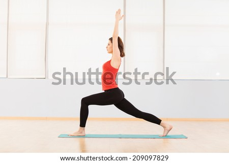 Fitness woman doing stretching exercise. beautiful girl working out and lifted hands