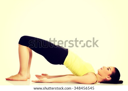 Fitness woman doing stretching exercise for spine.