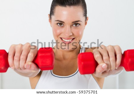 fitness woman exercising with dumbbell - stock photo