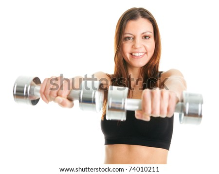 Fitness woman exercising with dumpbells - stock photo