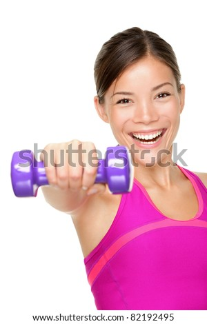 fitness woman. Fit fitness girl smiling happy lifting weights looking strength training shoulder muscles. Caucasian Asian fitness model isolated on white background. - stock photo