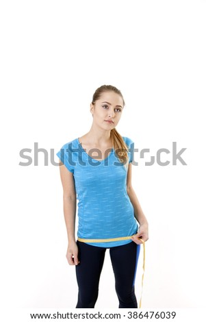 Fitness woman hip measuring tape, isolated on white background