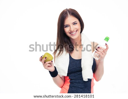 Fitness woman holding apple and bottle with water isolated on a white background - stock photo