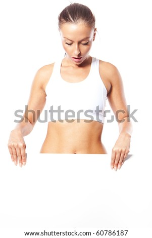 Fitness woman holding blank sign - stock photo