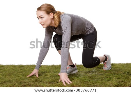 fitness woman in the get set ready go positions to run on grass - stock photo