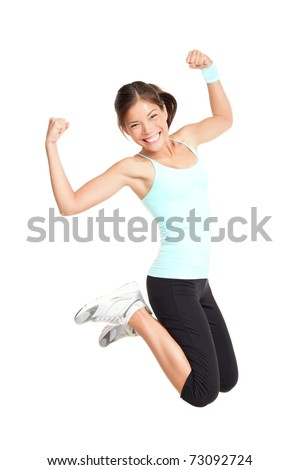 Fitness woman jumping excited isolated on white background. Full body image of beautiful multiracial Asian Caucasian female model in jump flexing and showing muscles. - stock photo