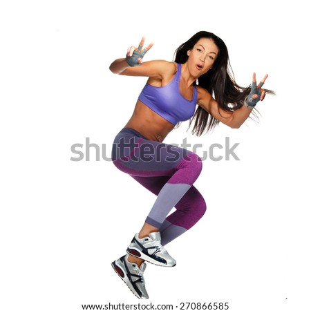 Fitness woman jumping of joy excited. Isolated on white - stock photo